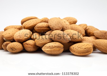 almonds with rind on white fund