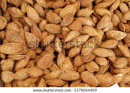 Almonds with shell. Fresh organic almond nuts with shells. Overhead view of raw organic almonds as a background. Healthy food concept. Vegetarian.  #1378066409
