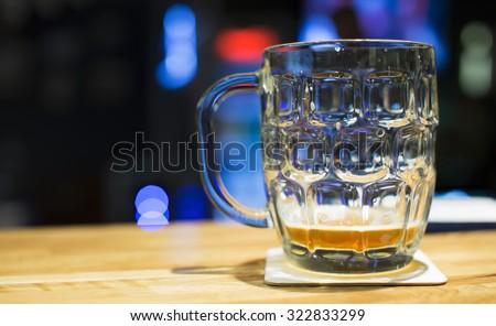 Almost empty glass mug of tasty craft beer in pub ストックフォト ©