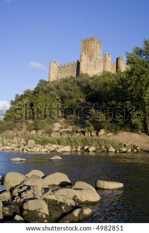 Almourol Castle (Castelo de Almourol) is a medieval castle in central Portugal situated on an island in the middle of the Tagus river.  It as a Knights Templar stronghold used during the Reconquista. - stock photo