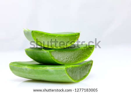 Aloe vera in pieces in front of white background #1277183005