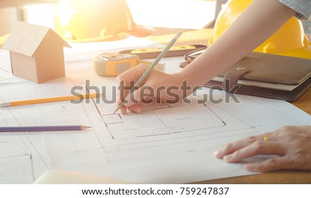Alone architect woman working with compasses and blueprints for architectural plan,engineer sketching a construction project concept.Architect concept,Vintage Effect #759247837