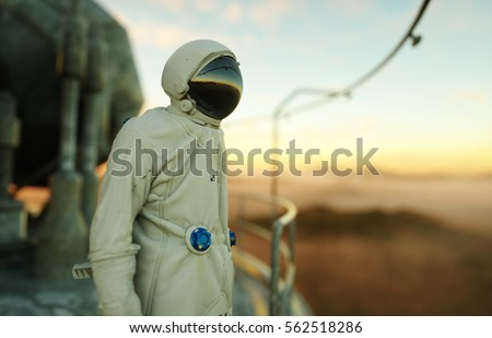 alone astronaut on alien planet. Martian on metal base. Future concept. 3d rendering. #562518286