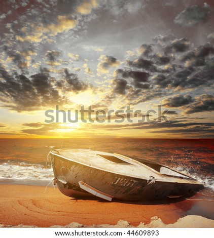 Alone boat on sea side under sunset light