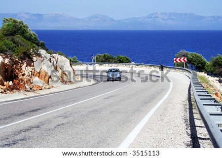 alone car on a sunny road at sea coastline