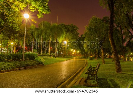 alone in the dark night at Chatuchak park in Bangkok. Chatuchak park is one of the oldest public parks in Bangkok.