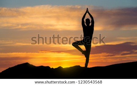 Alone man practicing yoga on sunrise, making breathing exercise. Motivation, wellness and peace concept, copy space #1230543568