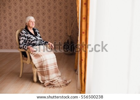 Free photos Portrait of smiling old woman sitting on a chair ...