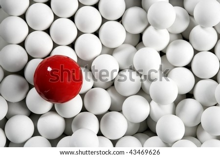 Alone one billiard red ball between little white table football balls