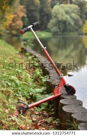 alone scooter in autumn garden #1312754771
