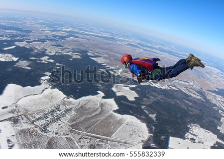 alone skydiver is in the free...