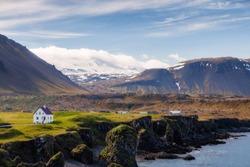 Alone standing house in fishing village of Arnarstapi in Western Iceland