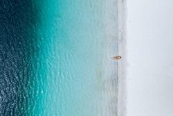 Alone swimmer in blue water Lake Mckenzie Fraser Island Queensland Australia