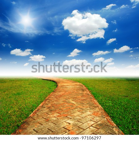 Alone way green grass cloudy blue sky to destination and green way to the future