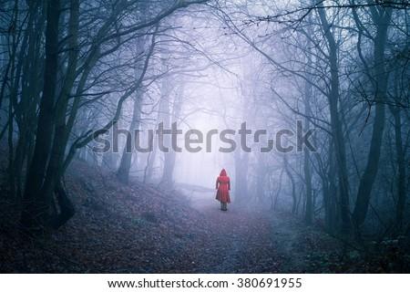 alone woman in dark forest #380691955