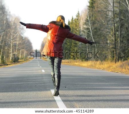 Alone woman walking on road