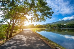 Along road landscape view in Ang Kaew Chiang Mai University Forested Mountain blue sky background with white clouds