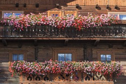 Alp house with a balcony with flower boxes