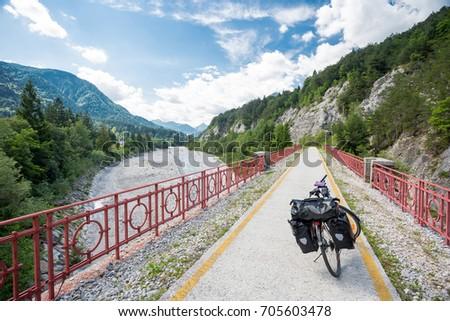 Alpe Adria cycle path, Italy. Touring bike. #705603478