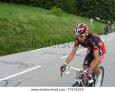 "ALPE D'HUEZ, FRANCE - JUN 12: Professional racing cyclist Matthieu Perget ride UCI WORLD TOUR "" CRITERIUM DU DAUPHINE LIBERE"" on June 12, 2010 in Alpe d'Huez pass, Isere, France."