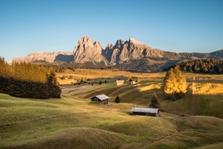Alpe di Siusi at sunset on a clear summer day, Dolomites, Italy, Europe. Seiser Alm is a Dolomite plateau and the largest high-altitude Alpine meadow in Europe.