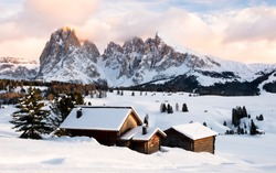 Alpe di suisi in winter at sunset covered in snow