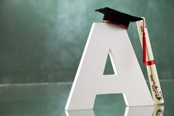 alphabet A with mortar board on it