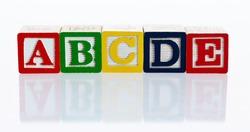 Alphabet ABCDE blocks on white background.