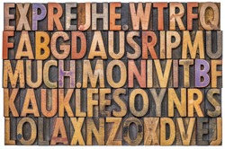 alphabet abstract in antique letterpress wood type printing blocks stained by color inks, isolated on white