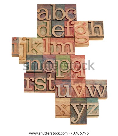 alphabet - abstract of vintage wooden letterpress printing blocks stained by color inks, isolated on white