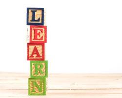 Alphabet Block spell the word learn.
