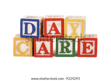 Alphabet blocks lined up to spell the word daycare isolated on white