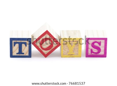 Alphabet blocks spelling the word toys with clipping path - stock photo