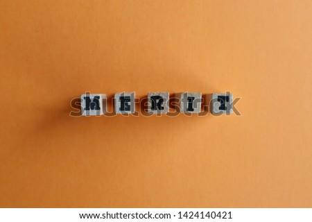 Alphabet blocks, wood texture, MERIT                                Stockfoto ©