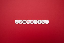 Alphabet communism word block with red background.