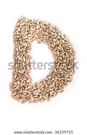 Alphabet D made of sunflower seeds.