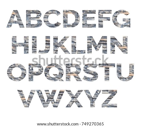 Alphabet from letters of stone. The letters are made of decorative stones #749270365