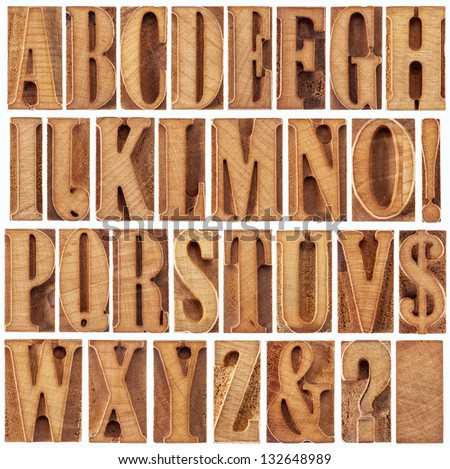 alphabet in modern letterpress wood type printing blocks (unused), a collage of 26 isolated letters, question mark, exclamation point, ampersand and dollar sign