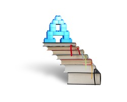 Alphabet letter A shape blocks on top of stack books stairs, isolated on white background.