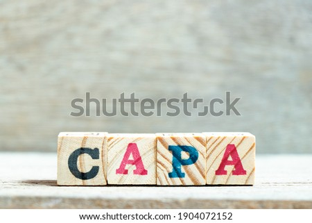 Alphabet letter block in word CAPA (abbreviation of corrective action and preventive action) on wood background Stock fotó ©