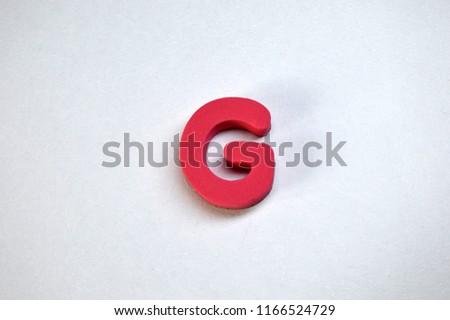 Alphabet letter G on a white background. Red 3d foam letter G. #1166524729