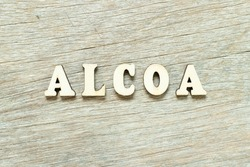 Alphabet letter in word ALCOA (Abbreviation of Attributable, Legible, Contemporaneous, Original and Accurate) on wood background