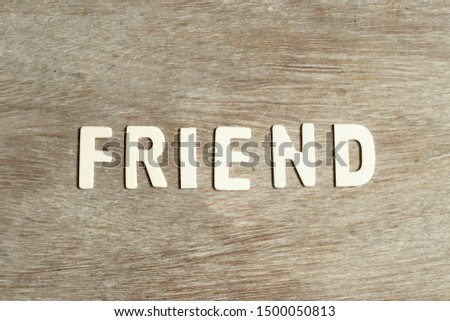 Alphabet letter in word friend on wood background #1500050813