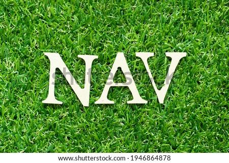 Alphabet letter in word NAV (Abbreviation of Net asset value) on green grass background Imagine de stoc ©
