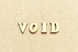 Alphabet letter in word void on wood background