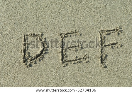 alphabet letters d e f  handwritten in sand on beach - stock photo