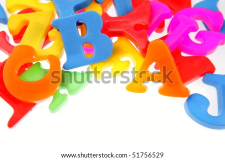 Alphabet letters on plain background