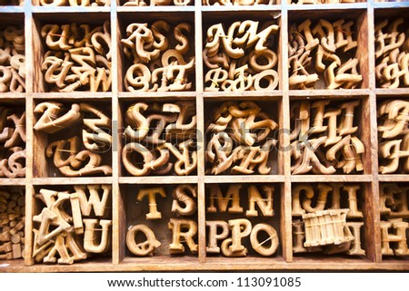 Alphabet made from wood in the square box
