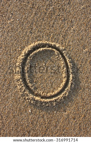 Alphabet's letter O handwritten in sand on the beach, at sunrise. #316991714