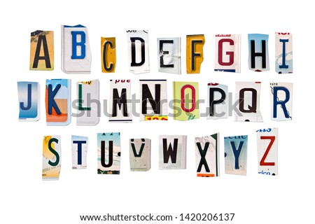 Alphabet set created with broken pieces of vintage car license plates on white background
